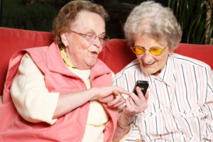 Elderly women looking at cell phone